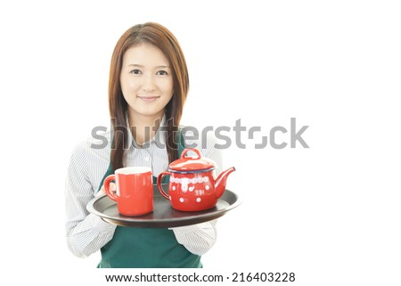 Portrait of young woman drinking coffee.