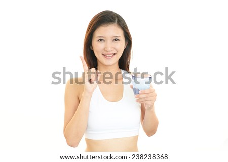 Portrait of young woman drinking glass of water.