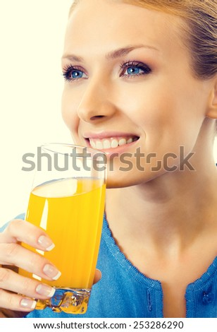 Portrait of young woman drinking orange juice - stock photo