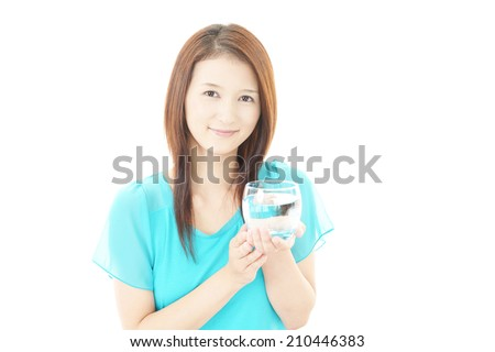 Portrait of young woman drinking water.