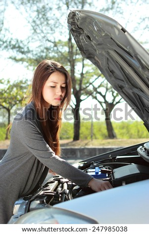 portrait of young woman get into engine problem on the way