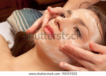 Portrait of young woman getting a spa treatment - stock photo