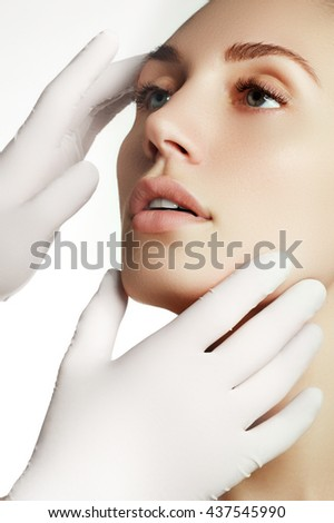 Portrait of young  woman getting cosmetic injection. Closeup of beautiful woman gets injection in her face. Filler injections.  Lip augmentation. Beautiful perfect lips - stock photo