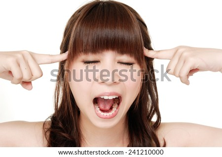 Portrait of young woman having a headache - stock photo