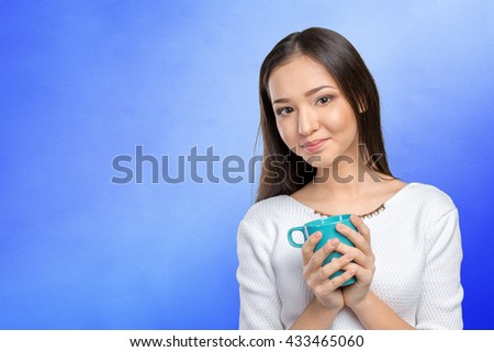 Portrait of young woman having coffee - stock photo
