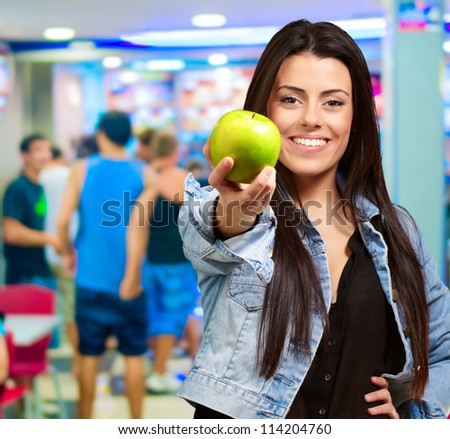 Portrait Of Young Woman Holding Green Apple, Indoors