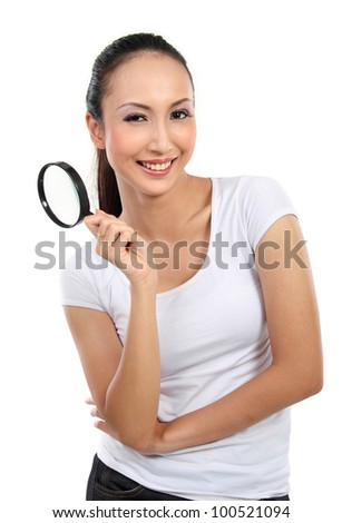 portrait of young woman holding magnifier glass isolated over white background - stock photo