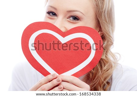 Portrait of young woman holding paper heart - stock photo