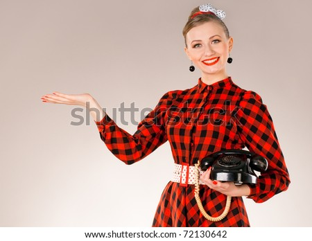 Portrait of Young Woman Holding Retro Phone - stock photo