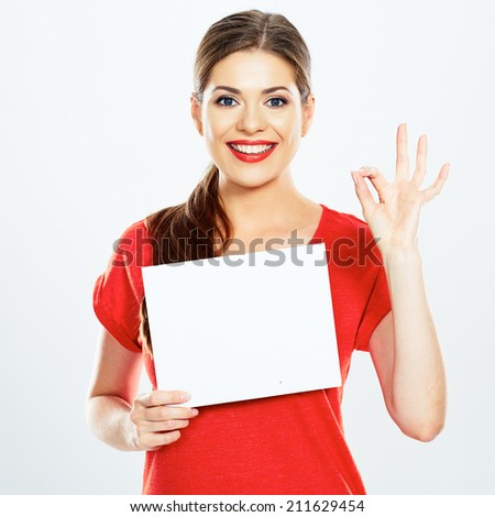 portrait of young woman holding sign card with O.K. symbol . white background . isolated . - stock photo