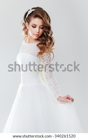 Portrait of young woman in a wedding dress - stock photo