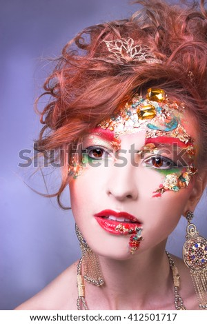 Portrait of young woman in artistic image
