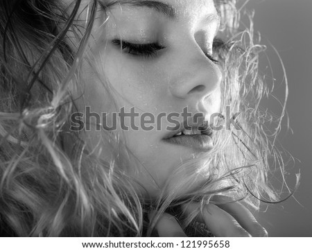 PORTRAIT OF YOUNG WOMAN IN BLACK AND WHITE - stock photo