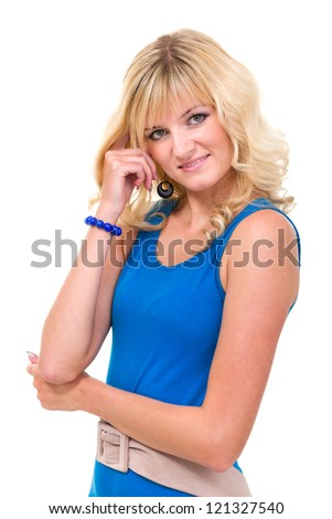 Portrait of young woman in blue dress smiling against white background