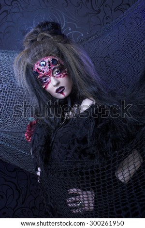 Portrait of young woman in dark artistic image of Spider-queen - stock photo