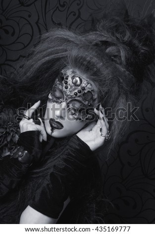 Portrait of young woman in dark artistic image of Spider-queen