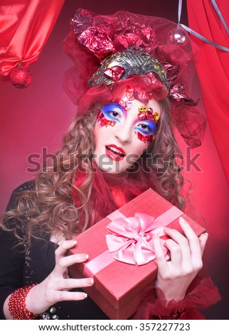 Portrait of young woman in eccentric holiday image.