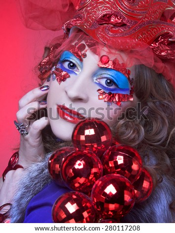 Portrait of young woman in eccentric New Year holiday image. - stock photo
