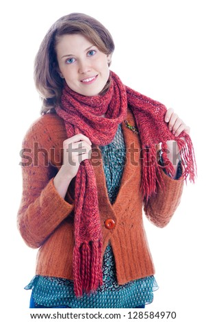 Portrait of young woman in knitted scarf - stock photo
