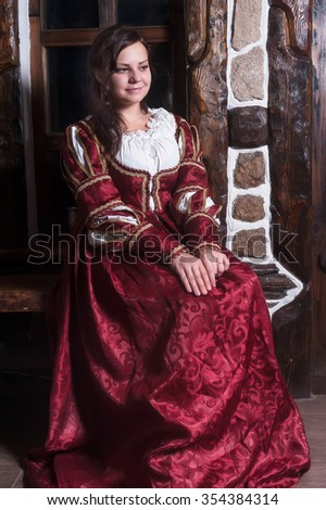 Portrait of young woman in Louis XIV style dress of the 16th and 17th centuries - stock photo