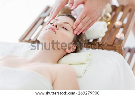 Portrait of young woman in massagist's room - stock photo