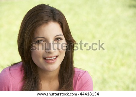 Portrait Of Young Woman In Park
