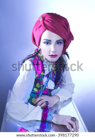 Portrait of young woman in pink turban and in vintage dress. - stock photo