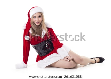 Portrait Of Young Woman In Santa Costume Over White Background - stock photo