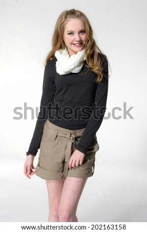 portrait of young woman in shorts with scarf posing - stock photo