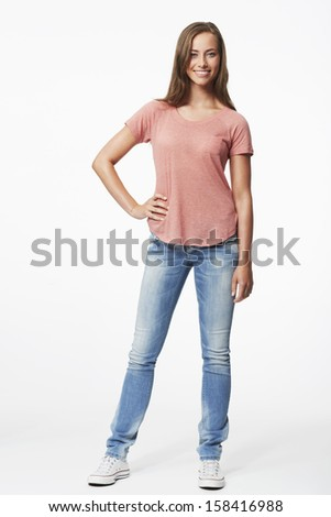 Portrait of young woman in studio, smiling - stock photo