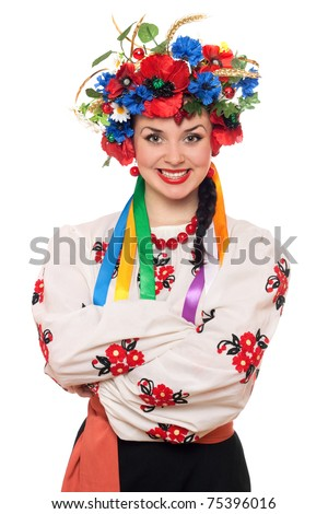 Portrait of young woman in the Ukrainian national clothes. Isolated - stock photo