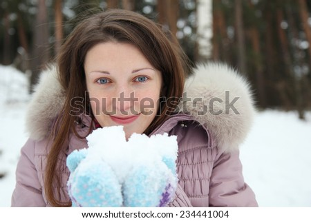 Portrait of young woman in winter - stock photo