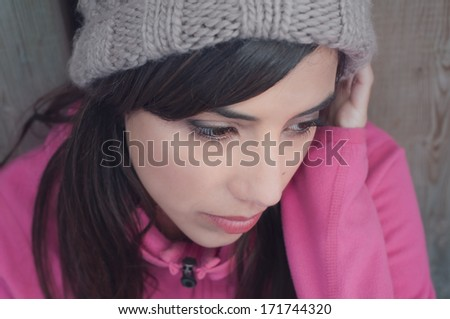 Portrait of young woman looking down and lonely