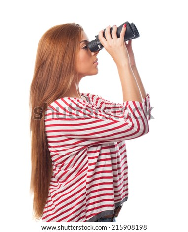portrait of young woman looking through a binoculars