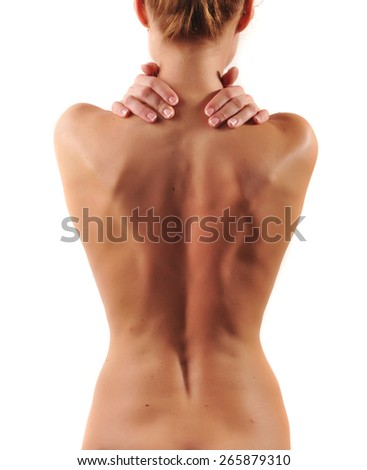 Portrait of young woman massaging her painful neck - stock photo