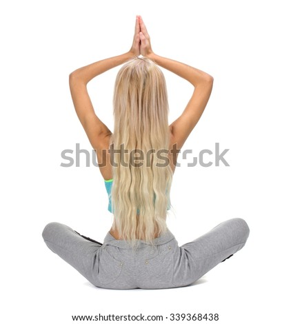 Portrait of young woman meditating in pose of lotus, back view, isolation on white - stock photo