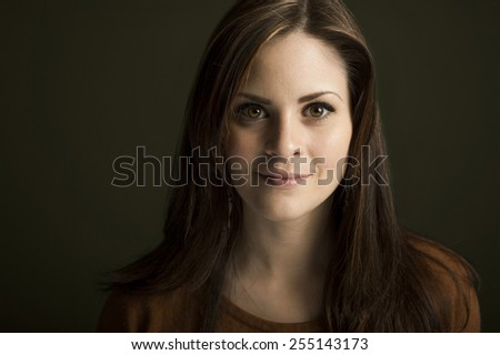 Portrait of young woman on green background