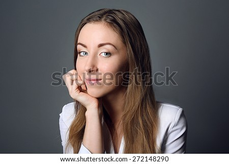 Portrait of young woman on grey background - stock photo