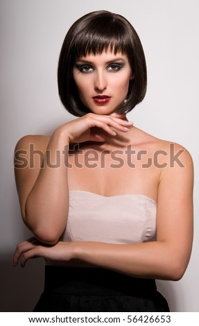portrait of young woman on grey background. - stock photo