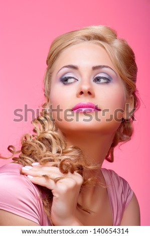 Portrait of young woman on pink background