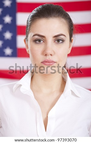 portrait of young woman over american flag - stock photo
