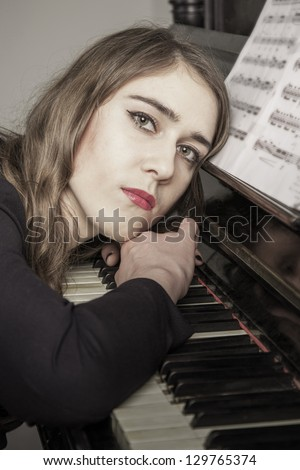 Portrait of young woman pianist close up - stock photo