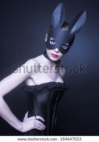 Portrait of young woman posing in rabbit mask.