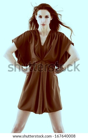 Portrait of young woman posing-light blue background  - stock photo