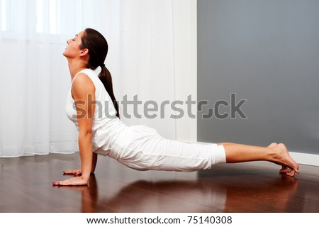 portrait of young woman practicing yoga - stock photo