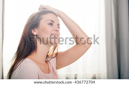 Portrait of young woman relaxing at home, casual style indoor shoot - stock photo