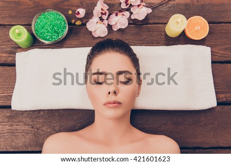 Portrait of young woman resting with closed eyes in spa