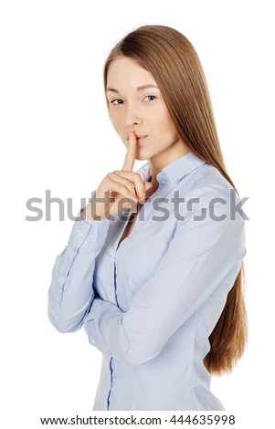 Portrait of young woman showing hand silence sign, asking someone to keep it quiet. human emotion expression and lifestyle concept. image on a white studio background. - stock photo