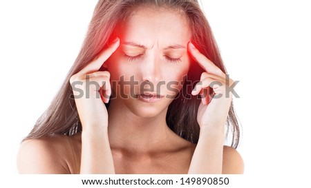 Portrait of young woman suffering from a terrible headache and touching her head