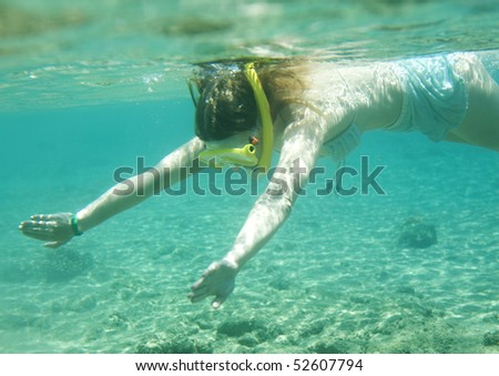 Portrait of young woman swimming in sea during her vacation